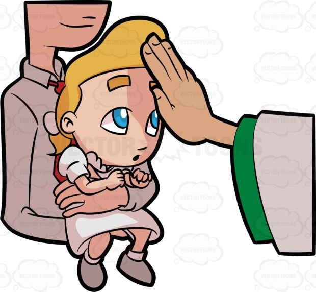 A baby girl being blessed by a priest on her forehead